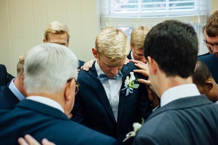 St Johns Church, Wedding Ceremony, Charlotte NC Wedding, wedding photography, groomsmen pray for groom