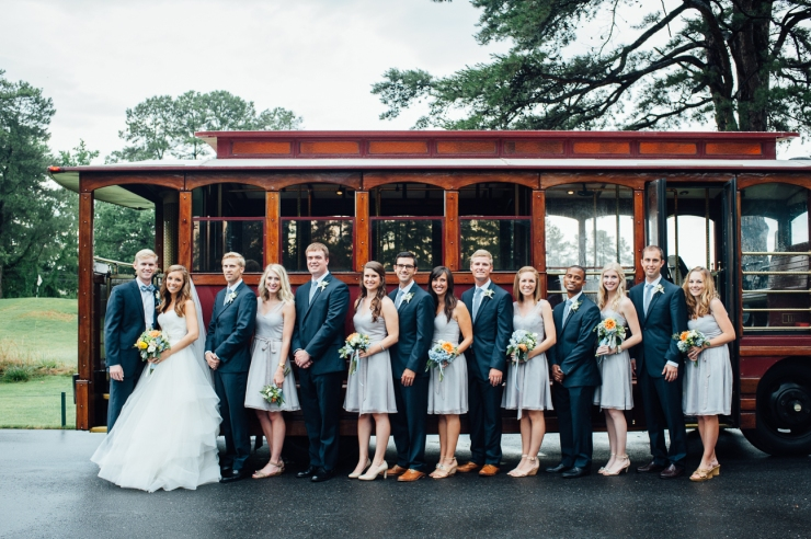 St Johns Church, Wedding Ceremony, Charlotte NC Wedding, wedding photography, wedding ceremony, bridesmaid and groomsmen in front of trolley