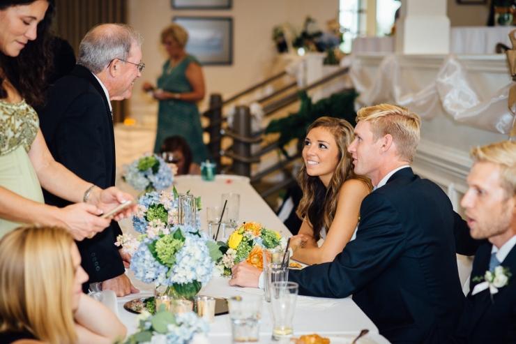 Carolina Golf Club, Wedding Reception, Charlotte NC Wedding, wedding photography, wedding ceremony, newlyweds talk to guests at reception