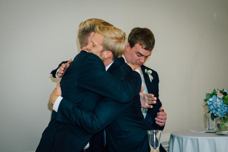 Carolina Golf Club, Wedding Reception, Charlotte NC Wedding, wedding photography, groom hugs friends after their toast