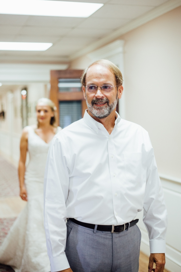 Image of bride's first look with her father