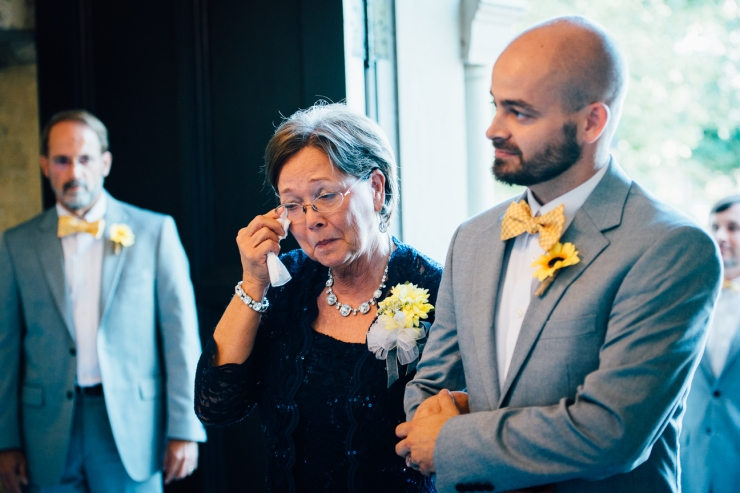 Image of Mother of the bride wiping tears