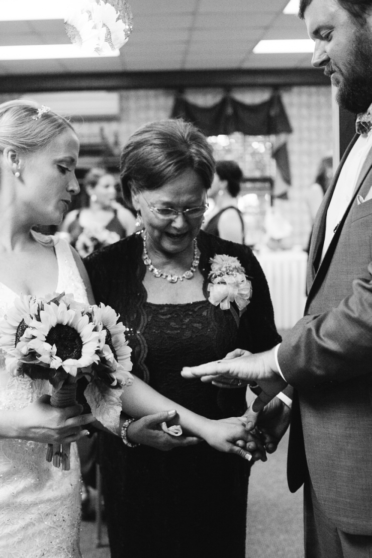 Image of mother admiring newlyweds rings