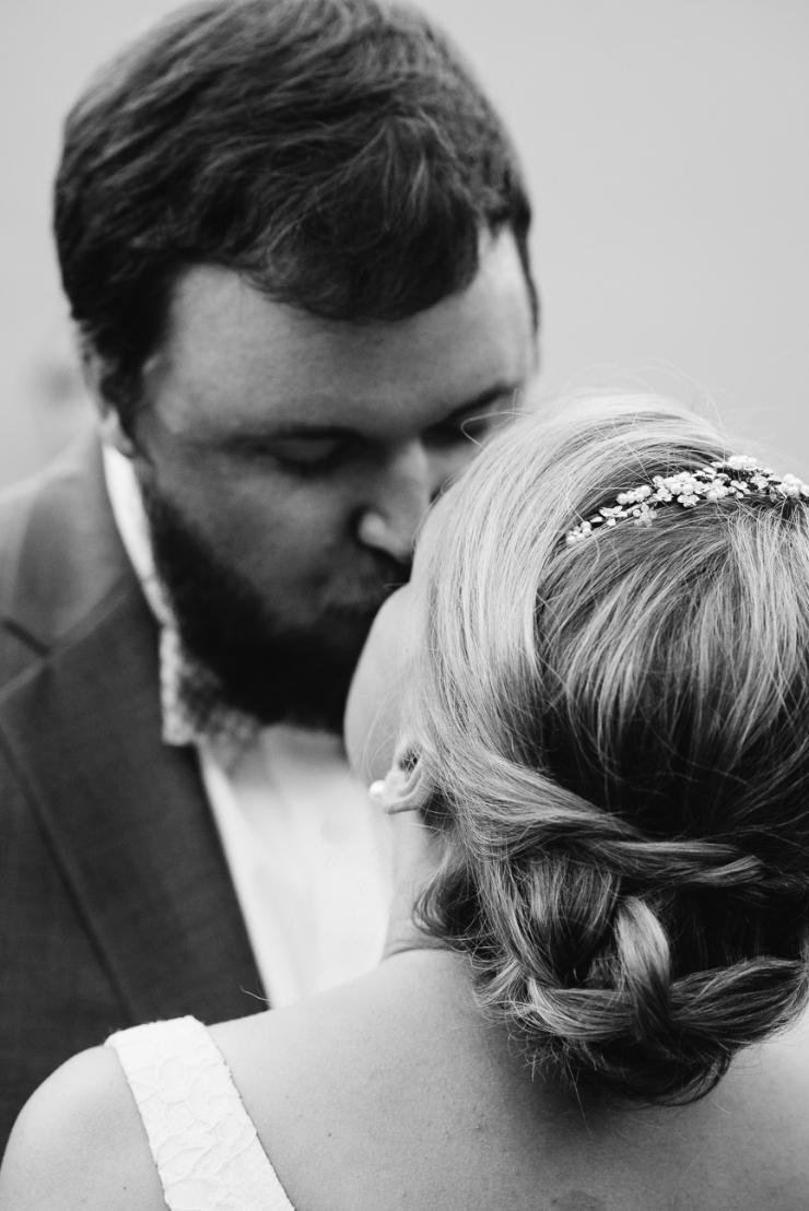 Image of newlyweds kissing during wedding reception in Augusta, GA.