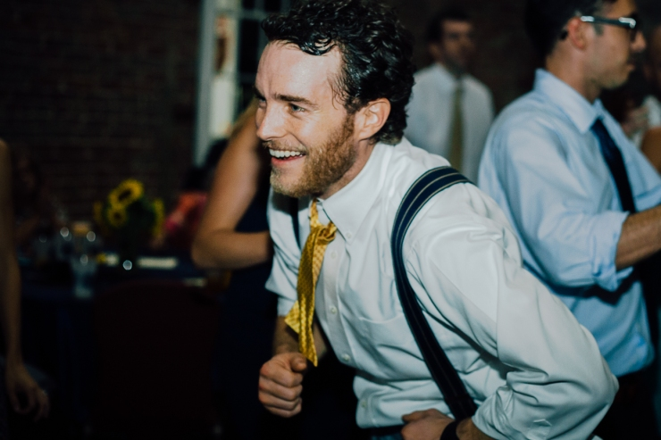 Image of groomsman dancing