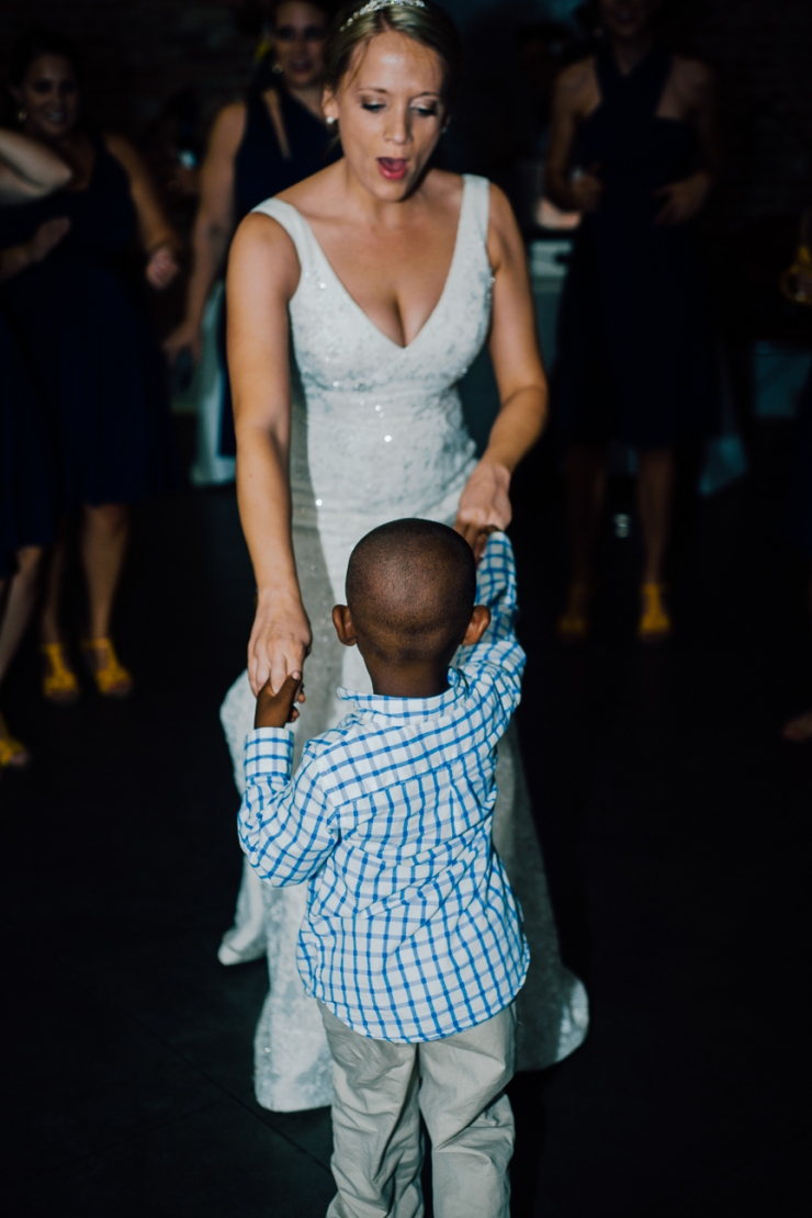 Image of bride dancing with little boy