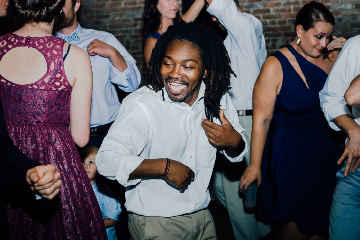 Image of groomsman dancing with guests