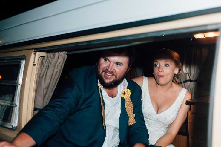 Image of newlyweds leaving in a VW van
