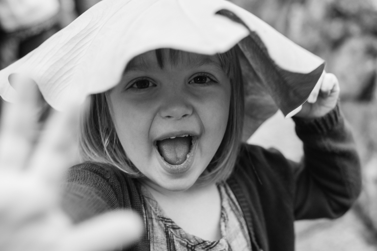 Image of young girl with a leaf hat during family photo shoot
