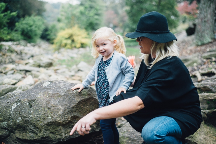 Image of young girl with her mother during family photo shoot