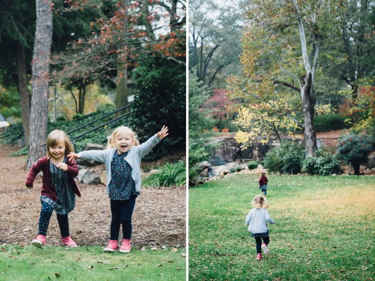 Image of young sisters racing during a family photo shoot in a Greenville SC park