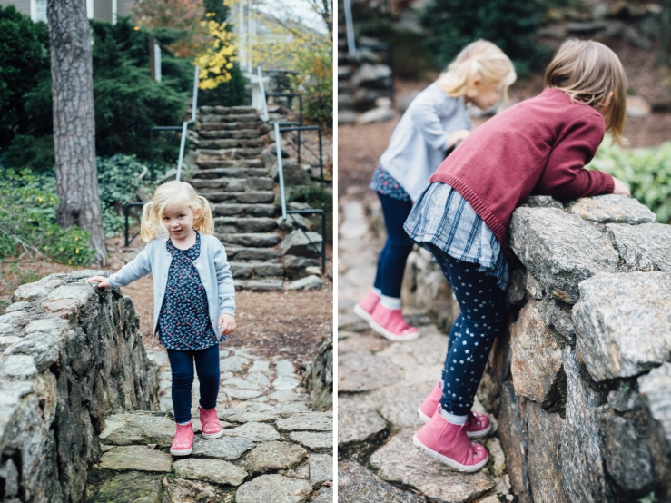Image of young sisters walking over a bridge during a family photo shoot in a Greenville SC park