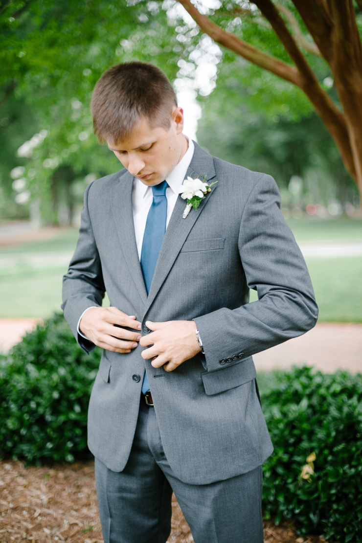 portrait of groom on wedding day at Furman, groom buttons jacket, Furman chapel, Furman wedding, greenville wedding photography