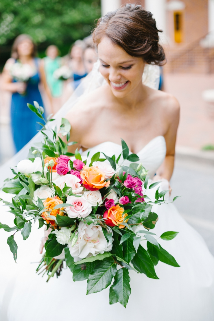 bride looks down at bouquet, bridal florals, wedding flowers, pink and orange garden roses, furman wedding, greenville wedding photography