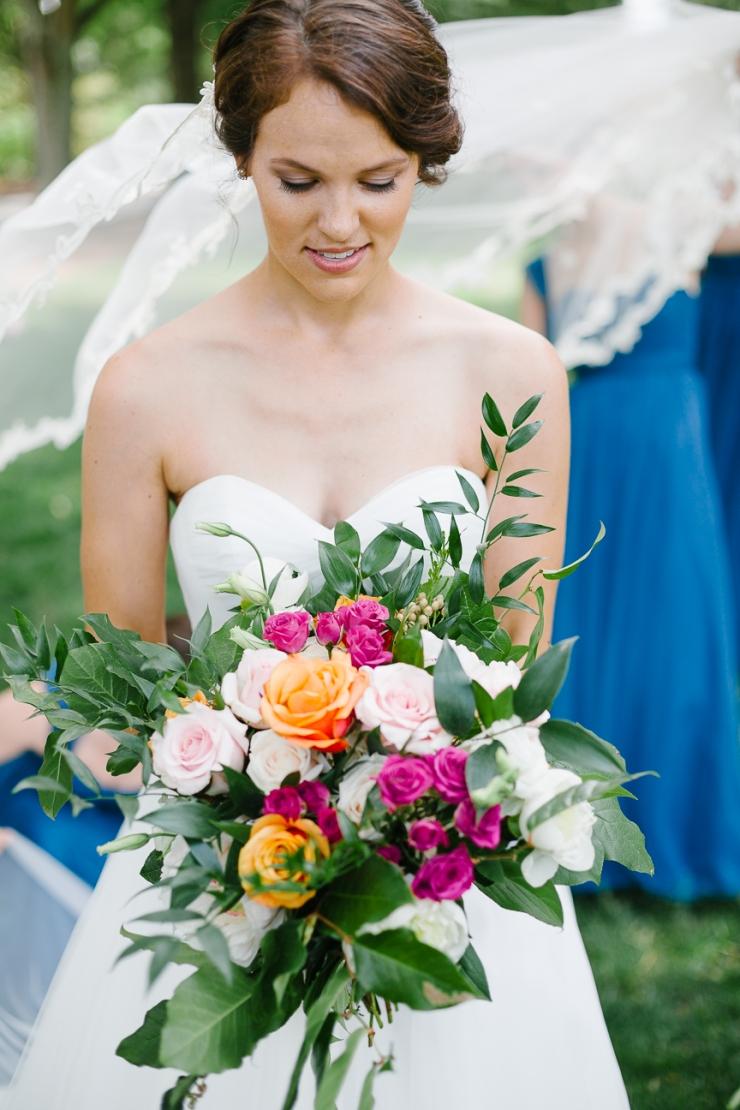 bride admires bouquet, floral, wedding flowers, Furman chapel, Furman wedding, greenville wedding photography
