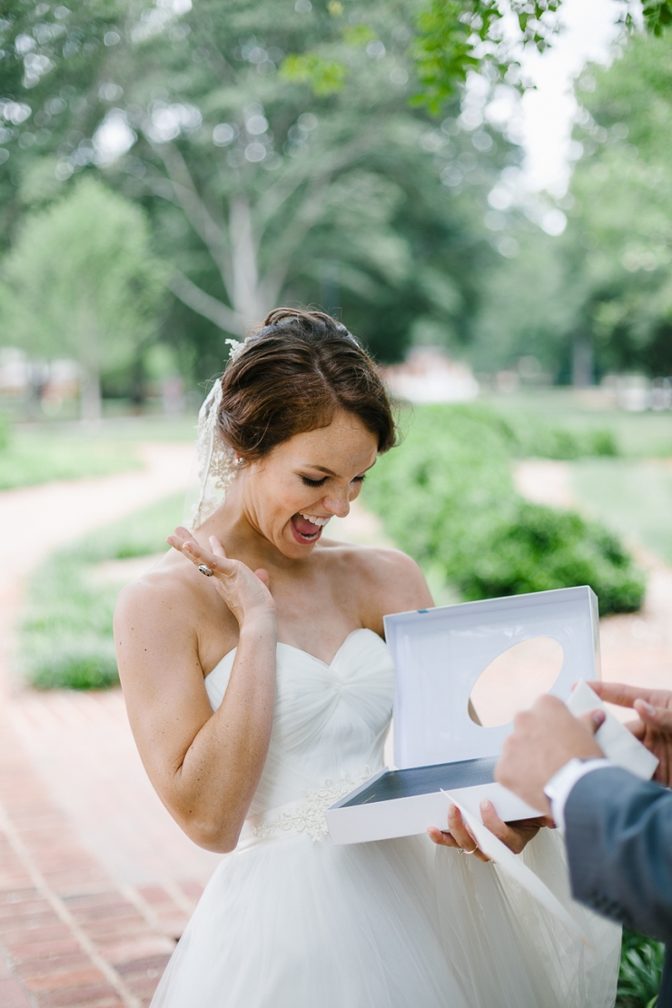 Groom gives bride a new bible on wedding day, Furman chapel, Furman wedding, greenville wedding photography