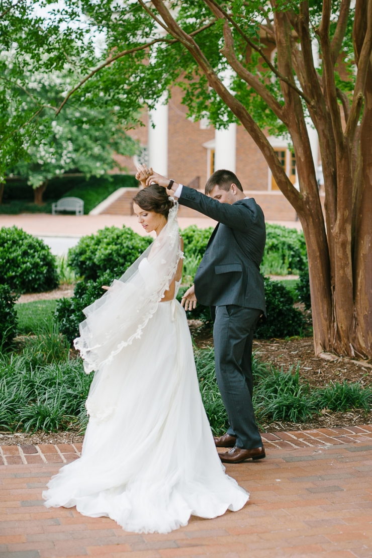 Groom twirls bride during first look at Furman Chapel, Furman chapel, Furman wedding, greenville wedding photography