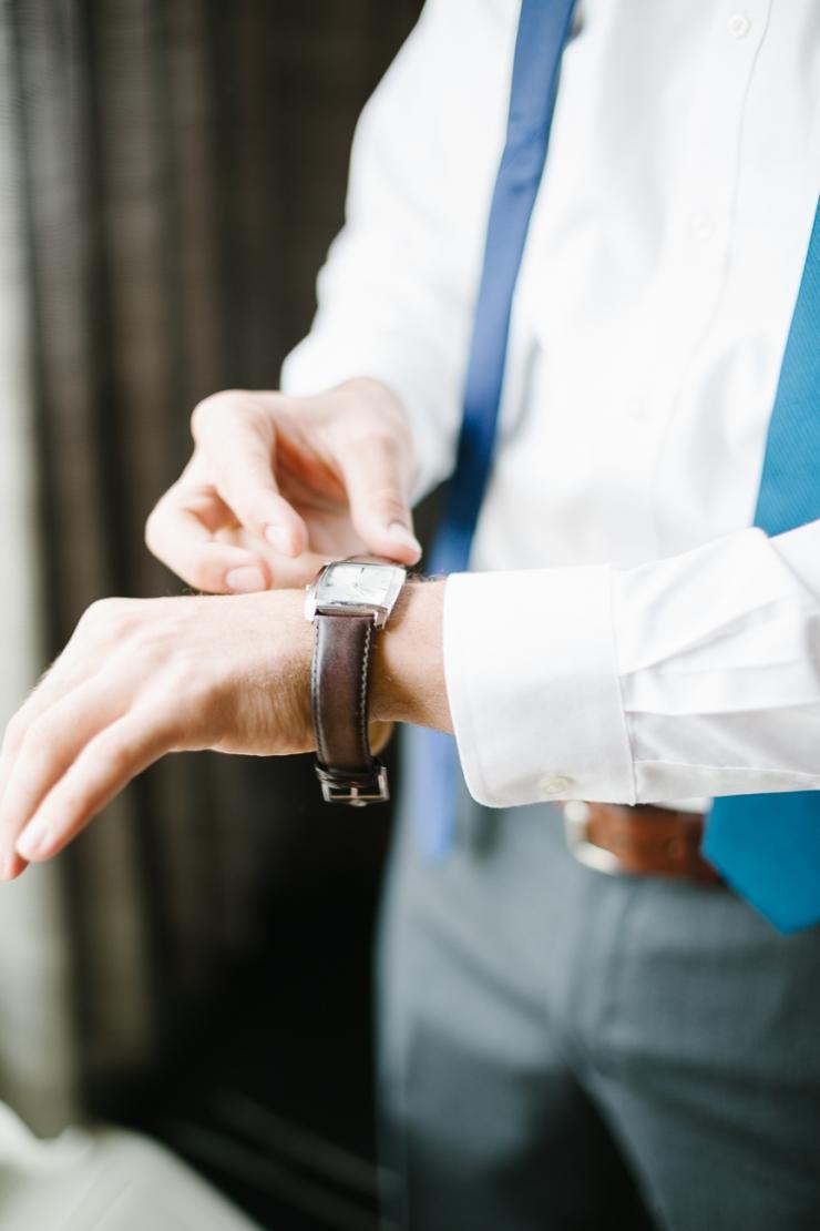 groom puts on his watch on wedding day, Furman chapel, Furman wedding, greenville wedding photography