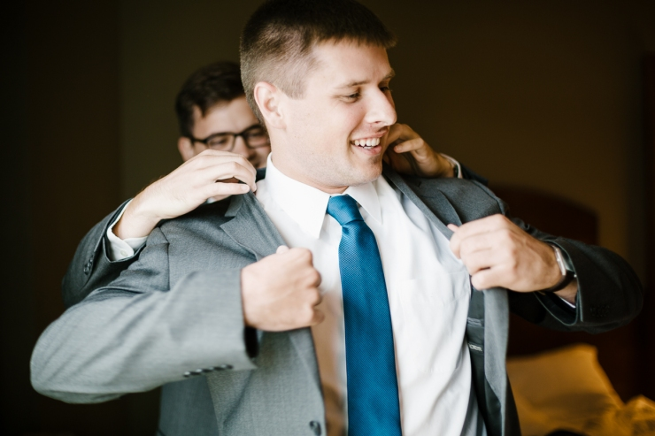groom outs on his suit jacket on wedding day, Furman chapel, Furman wedding, greenville wedding photography