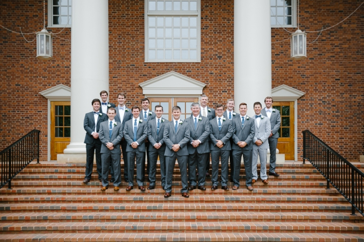 groomsmen and ushers stand on steps of Furman chapel, groomsmen portraits, Furman chapel, Furman wedding, greenville wedding photography