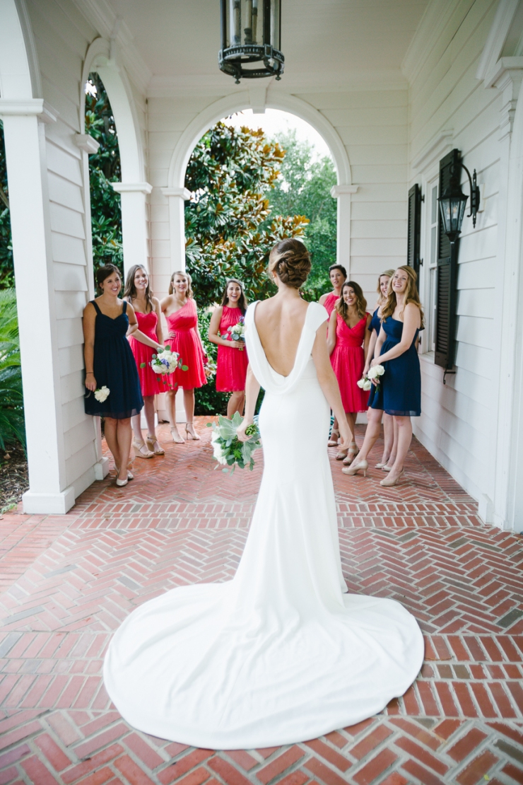back of bride's dress as bridesmaids look on during Myrtle Beach country club wedding