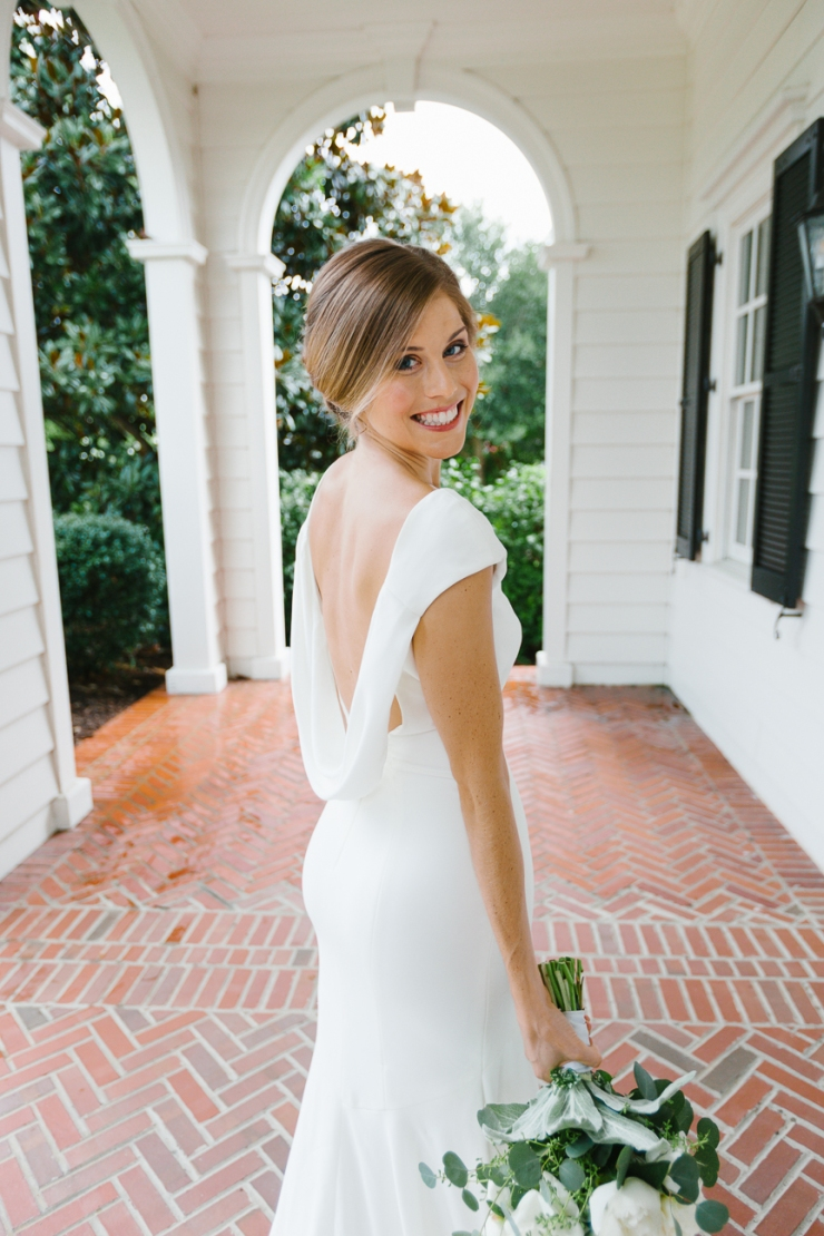 bridal portrait under a porch at Pine Lakes Country Club wedding