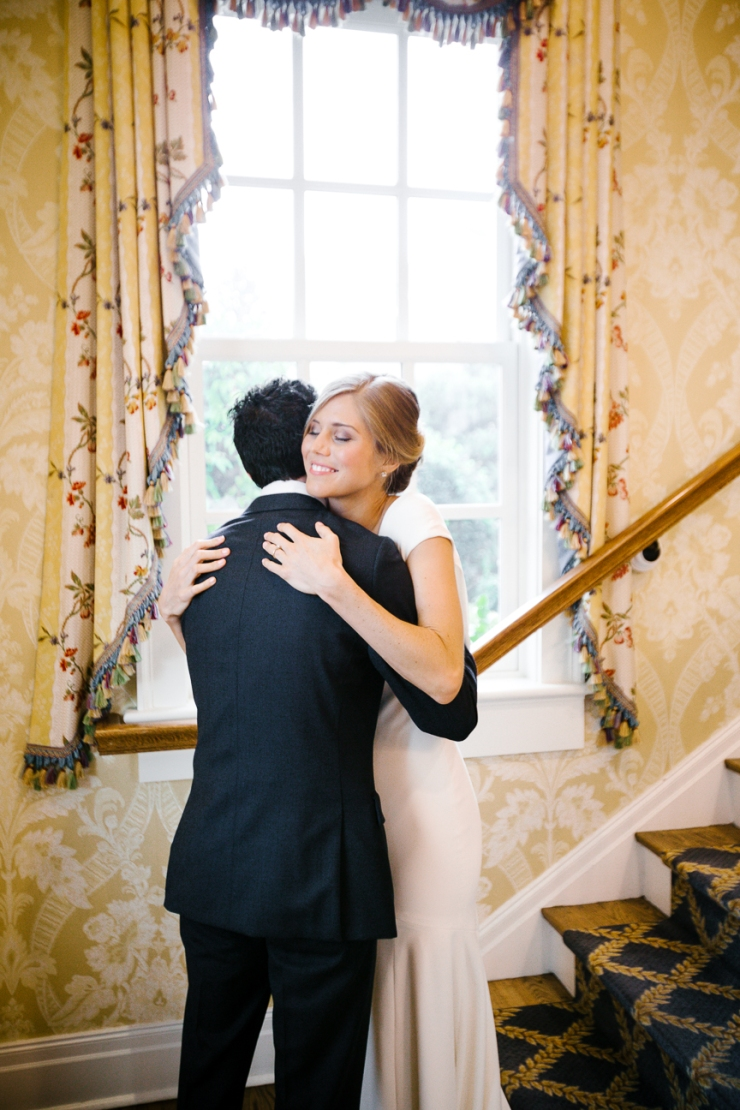 Bride and Groom hug during first look at Pine Lakes Country Club