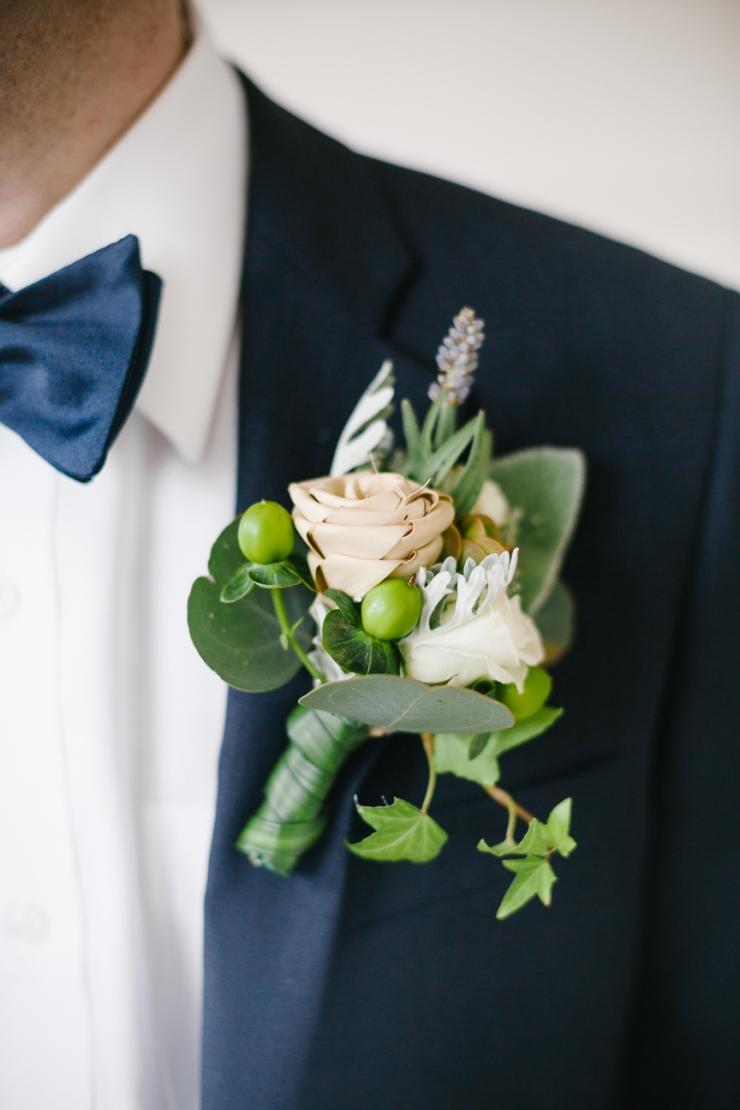 Groom's sweetgrass rose boutonniere