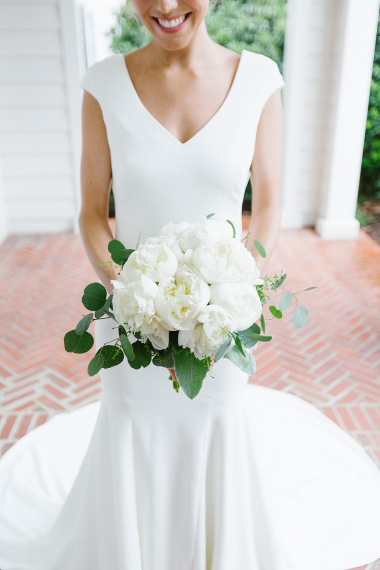 bride's all white peony bouquet