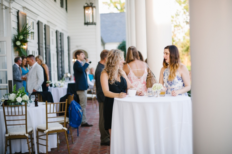 Guests on the porch at Pine Lakes Country club reception