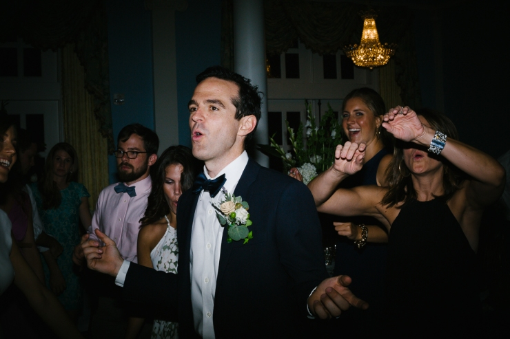 Groom dances to party band at Pine Lakes Country Club reception