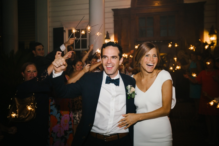 Bride and Groom leave their reception with sparklers