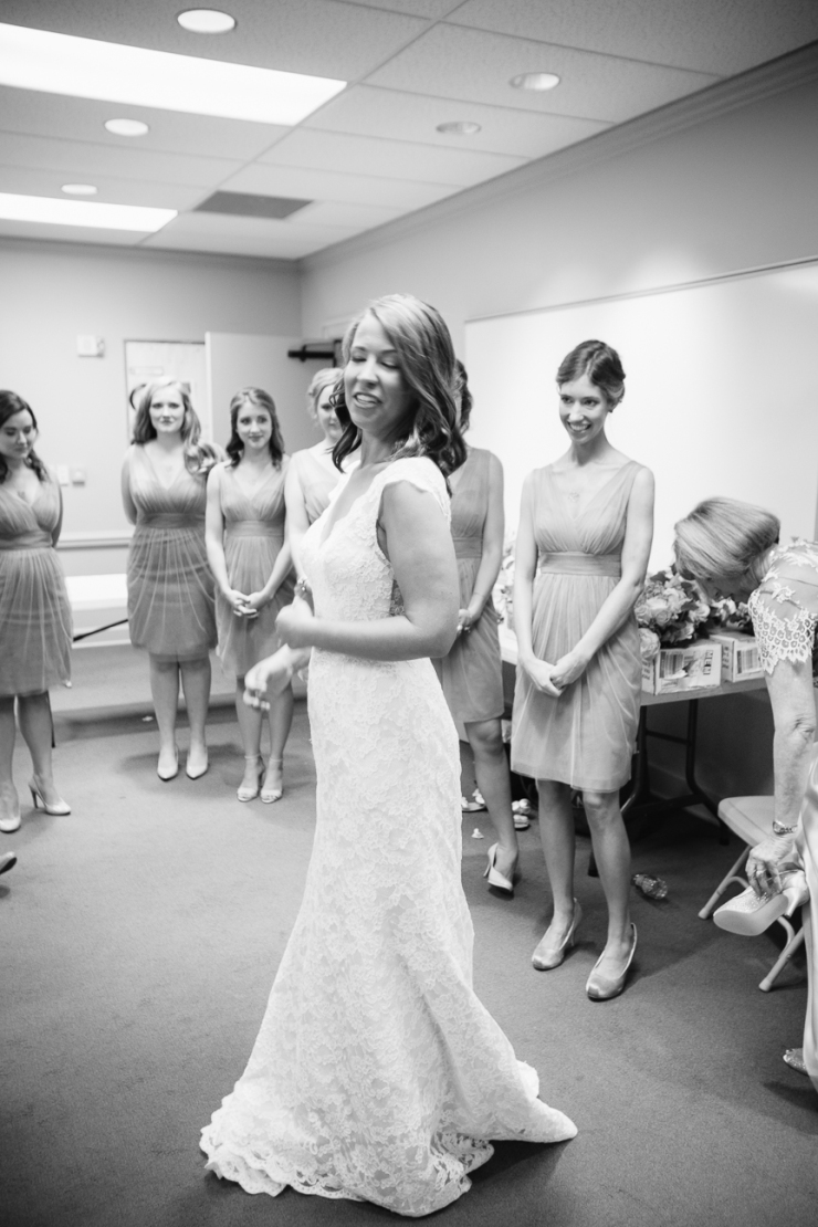 bride shows off wedding dress for bridesmaids in Memphis, TN