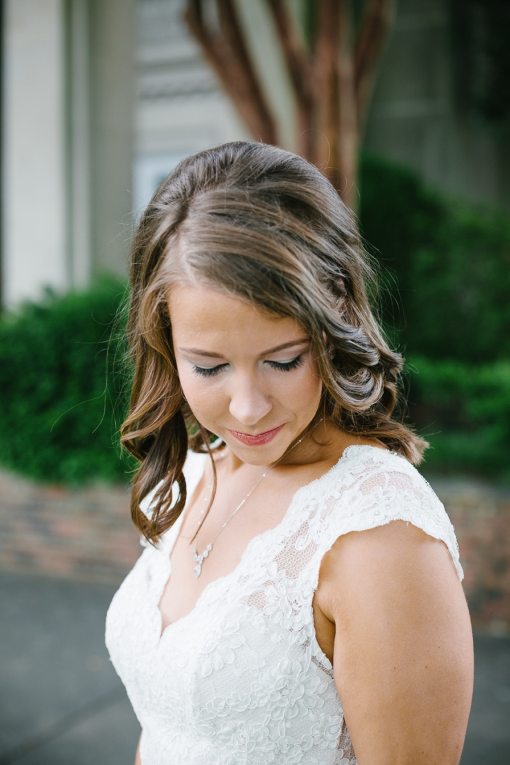Bride looks down at bouquet for portrait in Memphis, TN