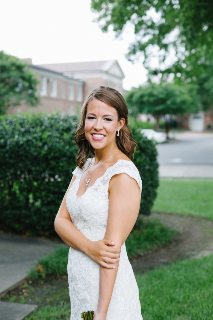 bride smiles for portraits in Memphis TN