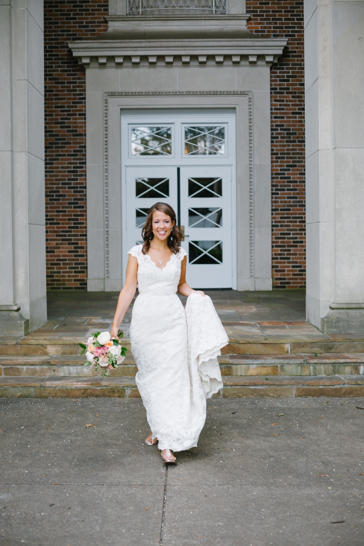 bride walks out of church in wedding dress