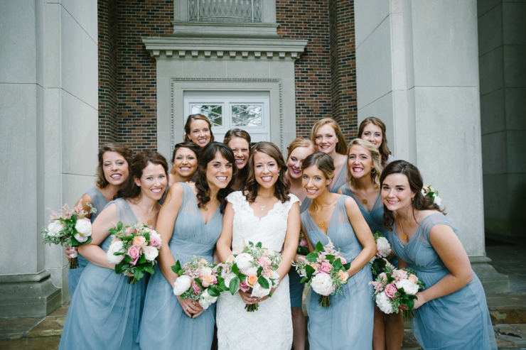 bridesmaids smile with bride outside church