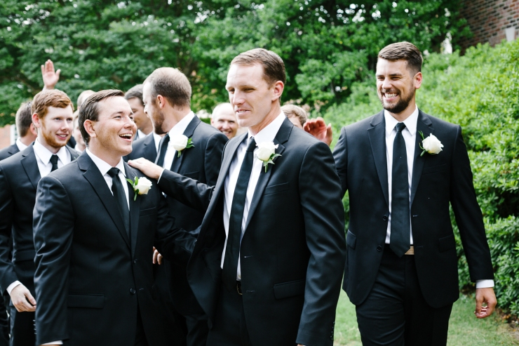 groom laughs with groomsmen in Memphis TN