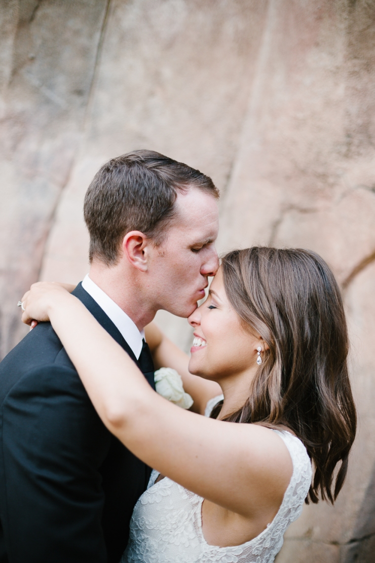 groom kisses bride's forehead at their Memphis zoo reception