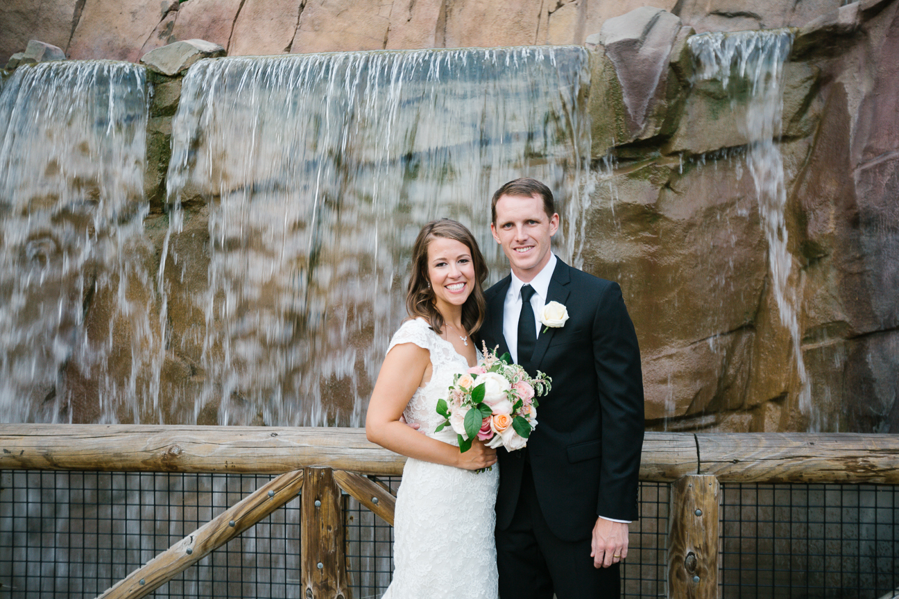 couple portrait in front of waterfall at Memphis zoo Teton Trek exhibit