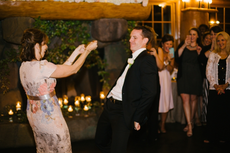 groom dances with his mother at Memphis zoo reception