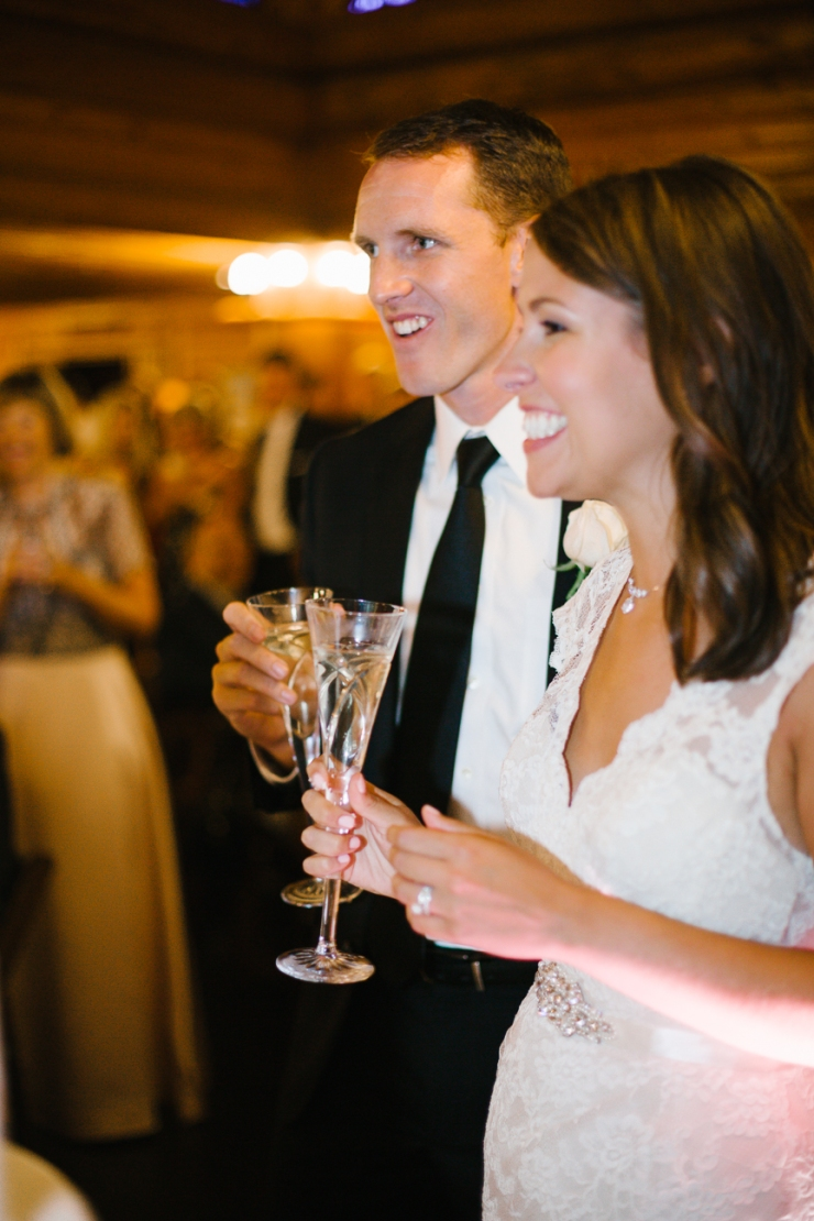 bride and groom share champagne toast at Memphis zoo reception