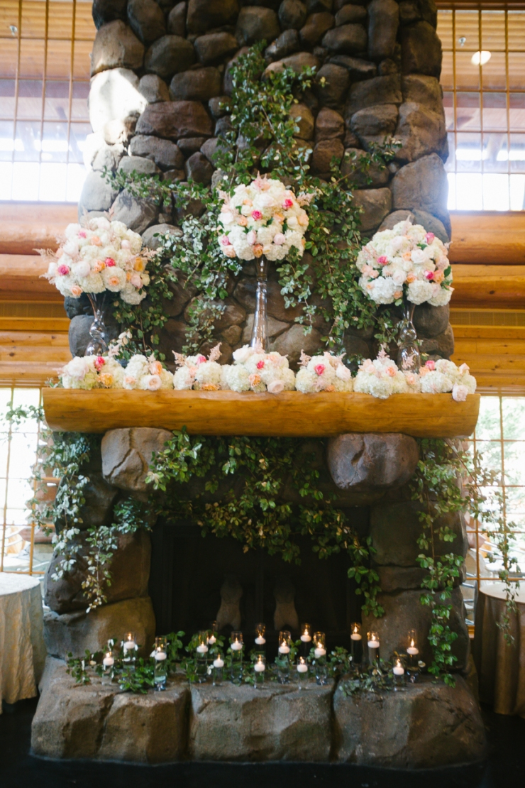 florals on fireplace at memphis tn zoo wedding reception