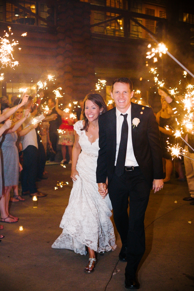 bride and groom exit the Memphis zoo under rows of sparklers