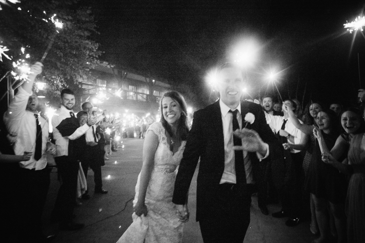 black and white images of bride and groom exiting the Memphis zoo under rows of sparklers