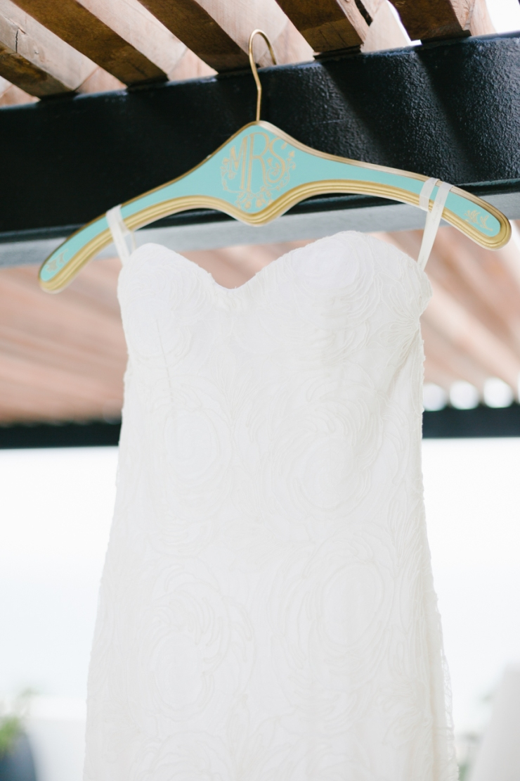 bride's Anna Maier gown on custom mint and gold monogramed hanger