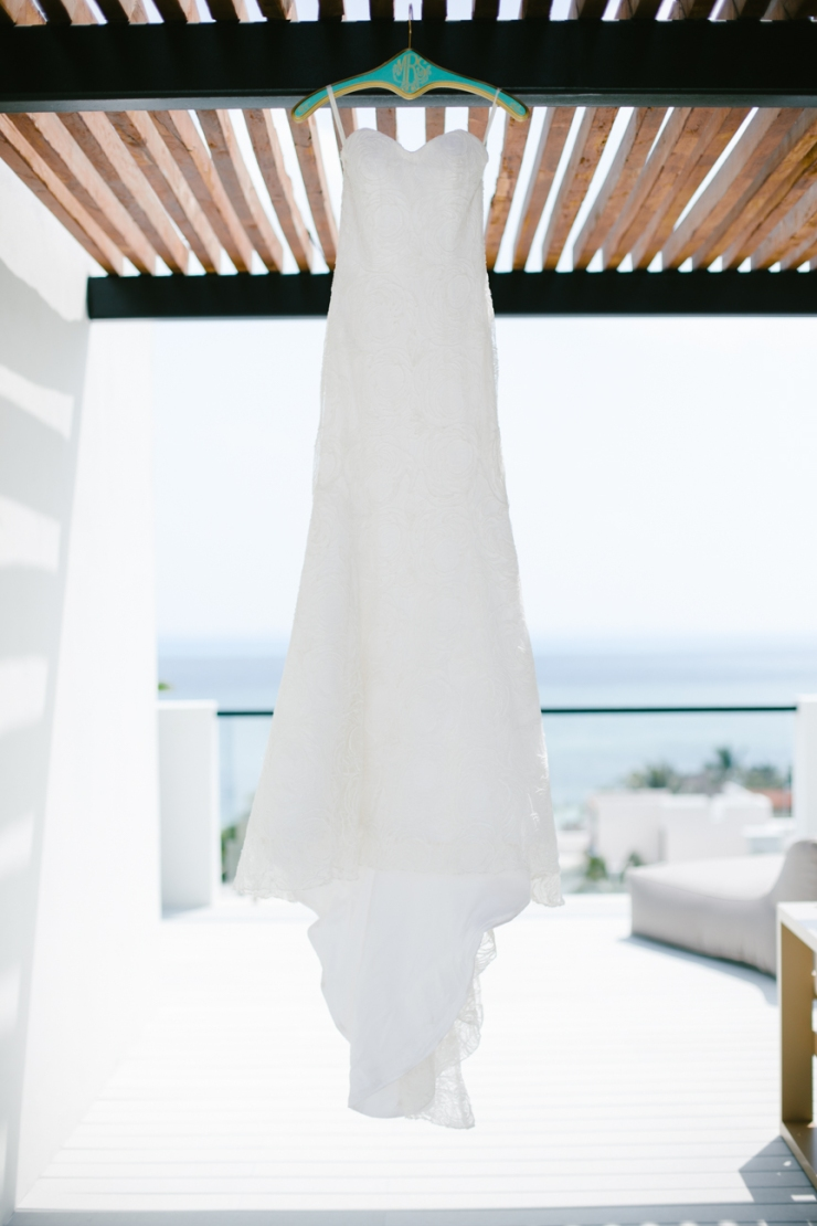bride's Anna Maier gown on custom mint and gold monogramed hanger on rooftop
