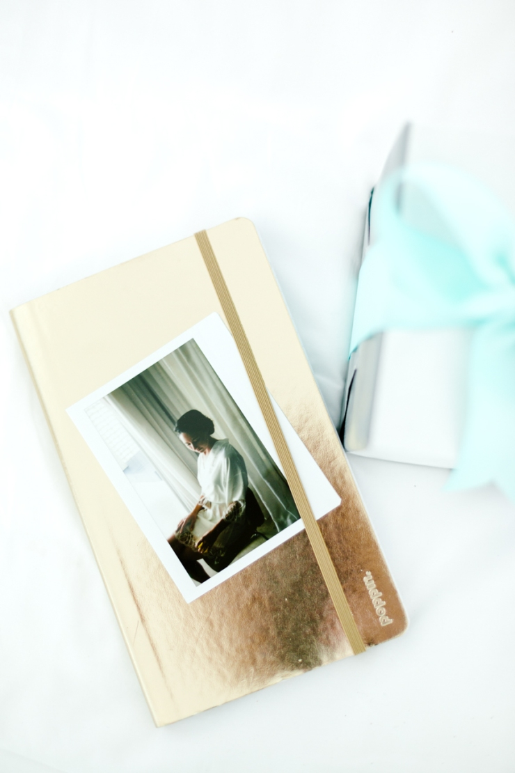Bride's gift to groom, gold journal and polaroid picture, watch