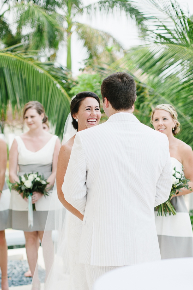 Bride laughs as she says her vows during mexico resort ceremony