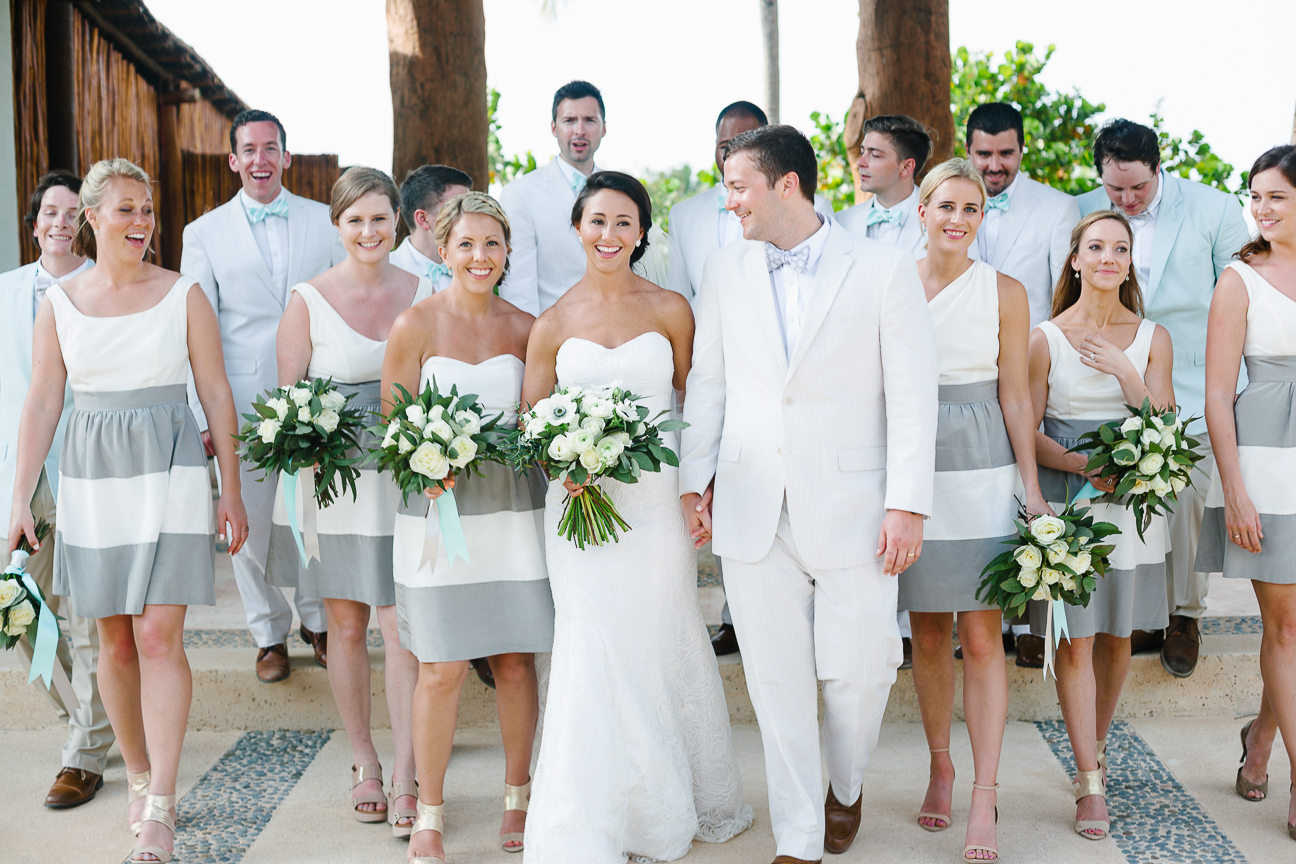 wedding party walks and smiles after Mexico wedding ceremony
